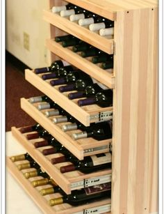 """Wine lover will definitely find our pull-out wine cradle rack essential to their wine collection simply because of its """"extended"""" functionality. The cradle can hold not only your standard-sized bottles and the usual Bordeaux and Burgundys, but also split-sized bottles and large champagne. #winerack #winecradle #winecellar Wine Storage, Kitchen Storage, Wine Bottle Storage Ideas, Storage Drawers, Wine Shelves, Kitchen Drawers, Kitchen Pantry, Wine Bottle Rack, Crate Shelves"""