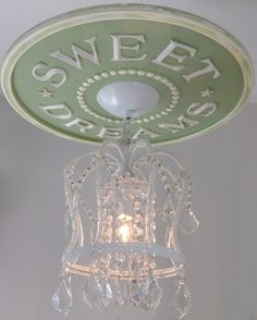 Nursery Ceiling Medallions by Marie Ricci. Sweet Dreams Ceiling Medallion shown in pale green distressed with white crown chandelier. www.mariericci.com