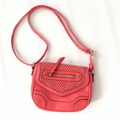Coral crossbody bag HOST PICK This is in great/ like new condition. Price is firm unless bundled.                                 I ship Mon-Fri 10am-4:30 NYC time. My first host pick!!  Urban Outfitters Bags Crossbody Bags