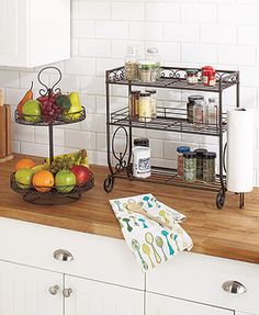 """Declutter your countertop with an elegant Metal Kitchen Organizer. Place fruitor everyday kitchen essentials in the 2-Tier Lazy Susan (12"""" dia. x 19-1/4""""H"""
