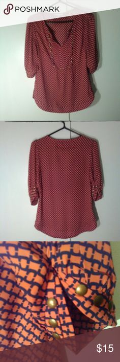 """HAWTHORN TOP HAWTHORN TOP. Trendy Orange and Black With Brass Colored Studs Adorning Front and Sleeves. Excellent Condition. Size Medium. Approx 26"""" From To Bottom. Sleeves Approx 15"""" Approx 18"""" Pit to Pit Laying Flat. 100% Polyester. HAWTHORN Tops Blouses"""