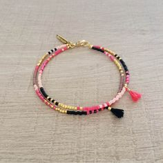Two-strand bracelet made of bright pink, metallic pink, black, mauve and gold glass beads and decorated with cute handmade tassels in matching colors.Please choose your desired size in the drop-down menu while adding to cart.-----------------------------✩ WRAPPINGAll of our jewels come in a beautifully crafted wrapping, so they are ready to be offered as gifts !-----------------------------♡ CRUELTY-FREEKurafuchi is 100% cruelty-free, which means none of ...