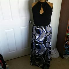Beautiful Floor length dress from Torrid This is a beautiful floor length dress.  It's a Torrid size 0. The dress is new without tags but has been washed. torrid Dresses