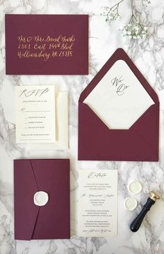 "We love these trendy Burgundy and Gold Glitter Pocket Wedding Invitations! The ""we do"" wax seal and envelope liner adds a unique and classic look to the invitation!"