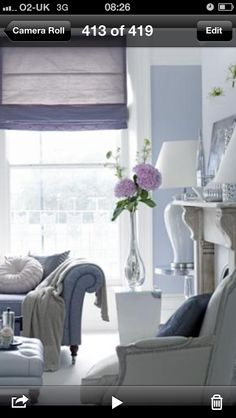 Pale grey living room with blue walls and lavender (but could be any color) accents