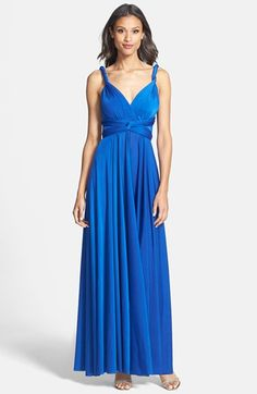 Free shipping and returns on Dessy Collection Convertible Wrap Tie Surplice Jersey Gown at Nordstrom.com. A cross-draped bodice and flowing A-line skirt give this dress a classic elegance while long straps can be twisted, knotted, draped or tied into a bow to create a look—and alterations-free fit—that's entirely your own and cinches right where you want it. Lightweight, easily packable jersey makes this style a great traveling option for destination weddings or honeymoons.