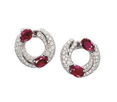 A PAIR OF RUBY AND DIAMOND EAR CLIPS, BY BULGARI  Each designed as a pavé-set diamond scroll accented by two oval-shaped rubies, mounted in 18k white gold, 2.2 cm long Signed Bulgari, no. 4R. 6.05