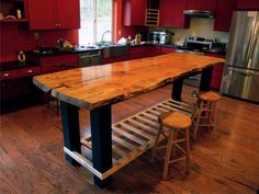 Handmade Custom Slab Island Table High Gloss Finishing Ideas Combined With Small Round Hardwood Stools And Wooden Rails Shelving On Mahogany Wood Flooring Ideas With Glass Kitchen Tables Also Home Styles Kitchen Cart of Affordable Home Kitchen Island Table Designs from Dining Room Ideas
