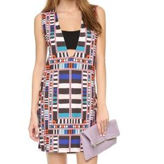 """Mara Hoffman Multicolor Bandeau Shift Dress A bright, geometric pattern lends an eclectic touch to this authentic Mara Hoffman dress. A wide band creates a peek-a-boo bandeau effect at the plunging V neckline.  Mid-weight jersey. 94% viscose/6% elastane. 33"""" long. Size XS in this brand fits a size 0-2; relaxed shift fit. On sale online: $258. Note: what looks like discoloration on parts of seam is not a defect - natural due to fabric. Not noticeable when wearing. New with tags attached…"""