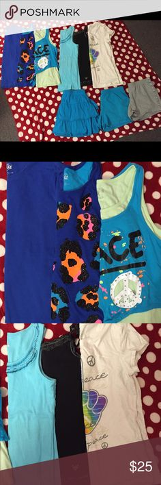 Justice Shirts and Shorts 2nd pic shows 1 navy blue shirt and 2 tank tops all size 20 Girls. 3rd pic shows 2 tank tops & 1 white shirt all size 18 Girls. 2 shorts & 1 skirt all size 18.  No stains or tears. Justice Shirts & Tops Tank Tops