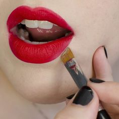 To clean up the edges around your lips, dip a slanted brush into concealer and apply it just outside your lips.