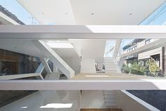 #Layered spaces in a #glass house are inviting and open