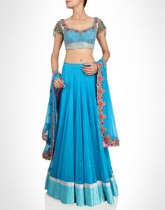 Blue lehenga subtly dotted with rhinestones and brocade hem. Shop Now: www.kimaya.in