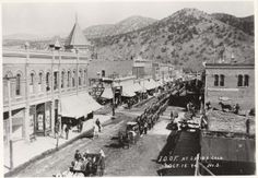 The International Order of Odd Fellows – during a statewide convention – parade up F Street October 15, 1894, preceded by dignitaries in carriages and followed by one of Salida's marching bands. Six years after the disastrous 1888 fire, there appears to be construction work in the lot on the corner of Second and F Streets where the Knights of Pythias building stands today. Alger's Drug Store is in the J. M. Collins building (with the large awning) at the left.