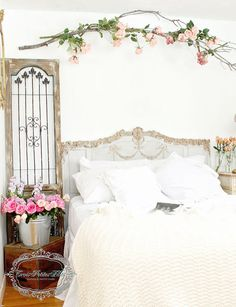 Create romantic home decor with something as simple as a branch and fresh flowers.