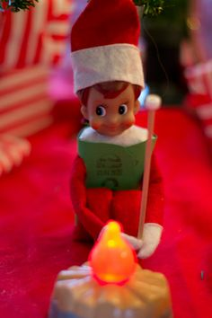 Our Elf on the Shelf Mr. Jingles roasting Marshmallows as a Girl Scout :)