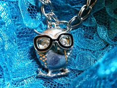 Check out this item in my Etsy shop https://www.etsy.com/listing/226362339/owl-on-silvertone-necklace