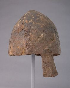 Early Helmet Date: 12th century Culture: probably French or British Medium: Steel Dimensions: H. 11 1/4 in. (28.6 cm); W. 7 1/2 in. (19.1 cm); D. 9 1/2 in. (24.1 cm); Wt. 2 lb. 14.3 oz. (1312.6 g)