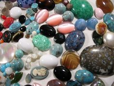 large assortment of glass and plastic vintage cabochons