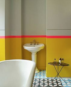 Home Remodel Modern Manish Arora Paris Apartment - A table for toiletries sitting on a tile floor in a Paris bathroom Bathroom Inspiration, Yellow Bathrooms, House Interior, Home, Interior, Paris Bathroom, Painting Bathroom, Colorful Interiors, Room Paint