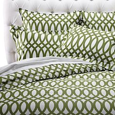 This spring, we believe in striking bold patterns and vibrant colors in bedding. Geo collection in bright Apple Green and White, $149.95