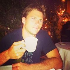 How cute is he drinking coffee? | 23 Beautiful And Perfect Photos Of Scott Eastwood