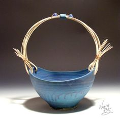 upright basket with reed handle in turquoise mat glaze
