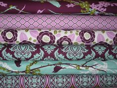 I think these will be my colors.  Lilac was my favorite color as a child.  (Joel Dewberry Aviary 2 lilac fabric for nursery bedding idea)