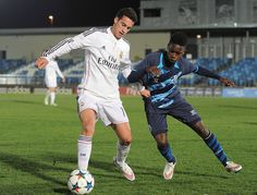 Moreto Cassamá of FC Porto battles for the ball with Jose Carlos Lazo of Real Madrid during the UEFA Youth League Round of 16 match between Real Madrid and FC Porto at Estadio Alfredo Di Stefano on February 17, 2015 in Madrid, Spain. #Moreto #MoretoCassamá #FCPorto #RealMadrid #Catiosport