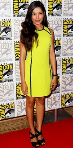 Look of the Day › July 25, 2011 WHAT SHE WORE The Immortals actress wowed the Comic-Con crowd in an acid yellow Michael Kors shift and strappy Dana Davis sandals. WHY WE LOVE IT Freida Pinto looked as bold (and beautiful!) as a comic book heroine in a daring neon hue accented with graphic leather piping.