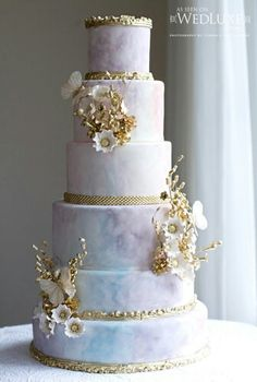 Pastel water color cake embellished with gold details
