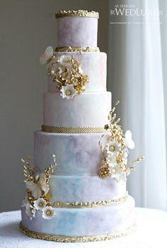 Pastel water color cake embellished with gold details