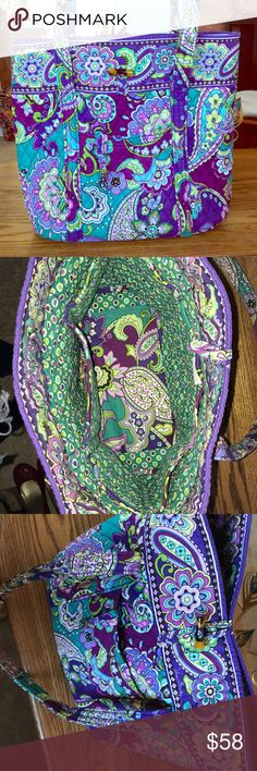 Vera Bradley tote Vera Bradley tote with a paisley design. Pockets on outside of tote: one zip, one open. Multiple open pockets along inside of bag. Button clasp closing on top. Small lanyard on inside of pocket on front, perfect for keys! Slight wear on bottom from use but otherwise is good condition! Perfect for work or school! Vera Bradley Bags Totes