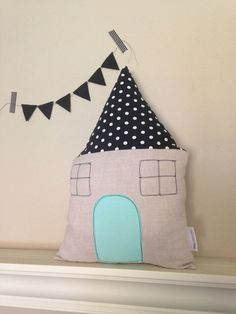 I love finding things that are both pretty and playful, and these adorable modern house pillows by Littlest Dwellings are absolutely both!