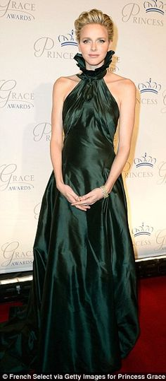 Gorgeous in green: The 35-year-old stunned in a royal green dress which featured an eye catching a high ruffled neck