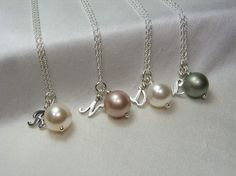 love this idea... initial pearl necklaces for bridesmaids (all same color tho)