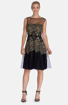 Free shipping and returns on Tahari Embroidered Mesh Fit & Flare Dress at Nordstrom.com. Shimmering golden embroidery enriches the sheer mesh of a delightful cocktail dress with an illusion yoke and a flared waist.