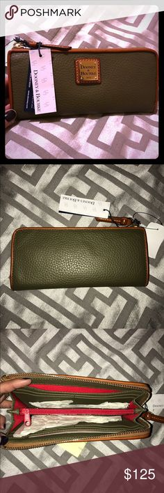 "✨NWT! Dooney & Bourke Leather Zip Clutch Wallet! ✨NWT! Dooney & Bourke Leather Zip Clutch Wallet! Take a hands-on approach to your look with this chic leather zip clutch. Featuring a pebbled leather exterior, a top-zip closure and a polished logo plate with contrast stitching at front. 7 3/4"" W x 4"" H x 1"" D Zip pocket, two open pockets and eight card slots at interior Imported Dooney & Bourke Bags Wallets"