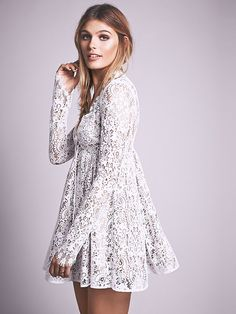Charlie Mini Dress | Long sleeve lace fit and flare mini dress with deep V-neckline, featuring a bow. Straight sheer sleeves that feature delicate eyelash trim accent. Fully lined with hidden zip closure at the back.