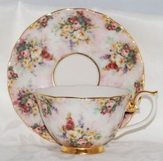 """Rare and seldom seen a Lena Liu Tea Cup and Saucer from the """"Glorious Chintz"""" collection. A series of these were created and I have a few in my collection of tea cups that I'm thinning out. This one is titled Remembrance and is a soft pink, trimmed in 14 carat gold with chintz flowers scattered all over it. Just lovely and in mint condition."""