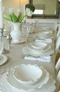 All white or cream coloured china is perfect for all seasons. Dress it up with flowers for spring and summer. Use herbs and evergreen branches during Christmas time. Elegant endless possibilities.  Very elegant.
