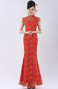 Chinese Qipao - Cheongsam Wedding Dress. I also like her headpiece.