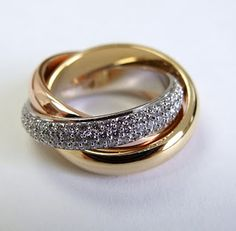 Cartier Trinity Ring. twist on a engagement ring! love it and the meaning too