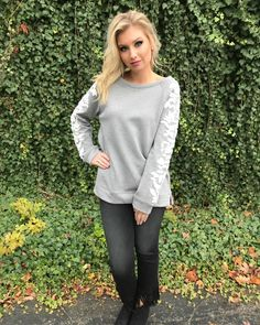 The sleeve details on this sweatshirt will have you saying Made You Look! ($64).  Featuring the Colton Straight Leg Fringe Bottom Jean.   Buy instore or have it shipped!  FAST & FREE SHIPPING from Ohio Sanitystyle.com 440.893.9279 sales@sanitystyle.com  to order or shop in store   #sanitystyle #sanitychagrinfalls #shoplocal #chagrinfalls #shopchagrinfalls #boutique  #freeshipping #cleveland #clevelandfashion #clevelandstyle #style #shop #cle #thisiscle #love #selloninsta #instasale…