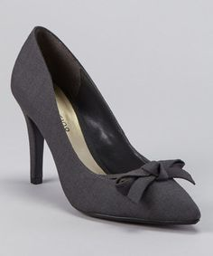 This classic pump is sure to send ladies strutting with style. From the darling front bow to the just-high-enough heel, this pair is perfect for popping the bubbly or adding some glamour to that office getup.