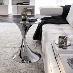 Andorra Tonin Casa End table with base in chromed or lacquered metal and tempered glass top. Andorra is a practical end table to place next to the sofa or can be used as a bedside. http://www.martinelstore.com/en/prod/accessories/coffee-table/andorra-tonin-casa.html