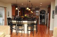Does your dream kitchen include an island and bar stands? Visit http://www.turnberrycustomhomes.com/ to transform your dreams into reality!