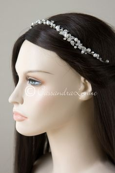 A perfect bridal hair vine for any outdoor or floral themed wedding.Two cluster of rhinestone dotted leaves are on either side of this ivory pearl headband. A b