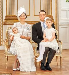 Princesses Leonore and Estelle of Sweden cuddle at Prince Oscar's christening | Daily Mail Online
