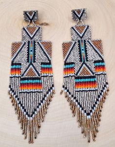 MADE TO ORDER: White Gold Thunderbird Earrings by wildmintjewelry